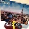 Photo Holder Rock - rock holding a photo of Paris, perhaps a postcard