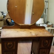 Finding the Value of a Vintage Dresser with Mirror - small dresser in need of refinishing with a large round mirror