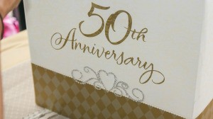 Box with 50th Anniversary written in gold.
