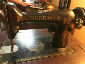 Value of an Antique Singer Sewing Machine - black Singer machine with gold lettering