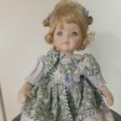 Identifying a Porcelain Doll - doll wearing a green print dress