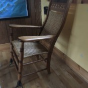 Identifying a Spring-foot Rocker - chair with springs on the front two legs, woven rattan back and seat