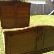 Value of an Antique Wooden Bed - bed set up outside