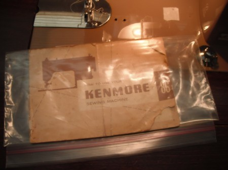 An old Kenmore sewing machine manual in a plastic bag.