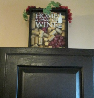 Using My Collection Of Wine Corks For Decorating - finished wine and cork decor on top of a black cabinet
