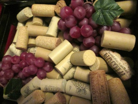 Using My Collection Of Wine Corks For Decorating - add corks and faux grapes