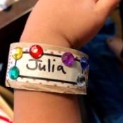 Making Paper Roll Kids' Cuff Bracelets - finished cuff bracelet on child's wrist