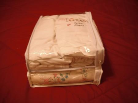 Linens stored in a clear zipper bag.