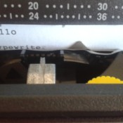 Repairing a Smith Corona SL575 Typewriter - closeup of  a page in the typewriter with a letter corrected