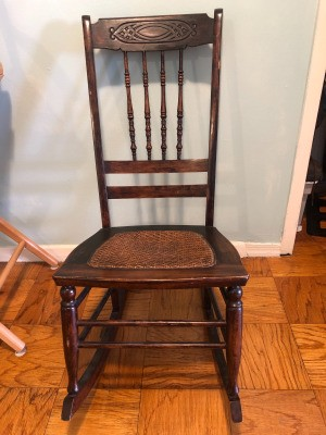 Value of an Antique Rocking Chair - high backed dark wooden rocking chair