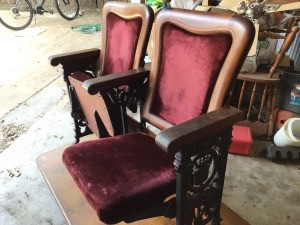 Identifying Theater Seats and Age - upholstered seats, with wood trim, and ornate cast sides