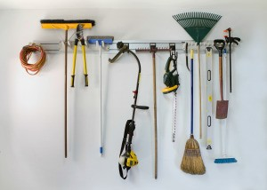 Neatly stored tools on a garage wall.