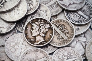 A collection of old silver dimes and quarters.