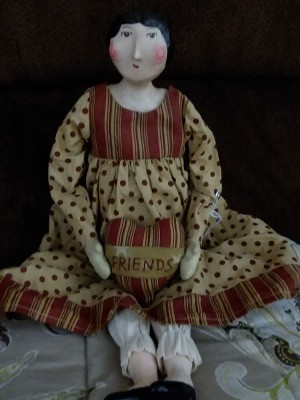 Value of a Sharon Andrews Porcelain Doll - primitive looking porcelain doll