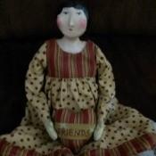 Value of a Sharon Andrews Porcelain Doll - primitive looking porcelain doll