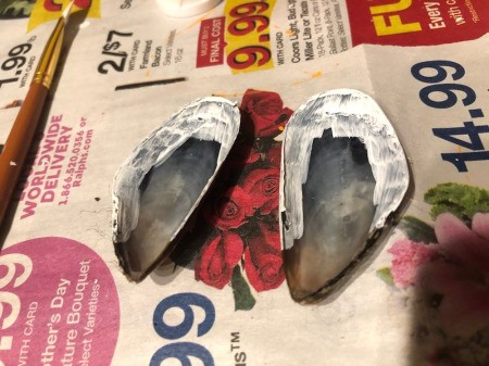 Make a Bunny from Shells - paint the inside edges of the mussel shells white to begin making the ears