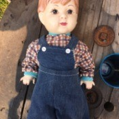 Identifying a Porcelain Doll - boy doll wearing overalls