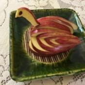 Edible Apple Swan - swan on a green ceramic dish
