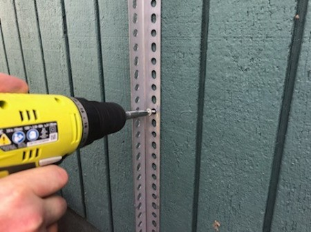 drilling the metal corners to the house.