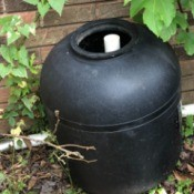 Garden Uses for an Empty Pool Filter - black plastic drum