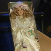 Value of a Carolynn's Collection Porcelain Doll - doll, perhaps a bride, in a white satin dress, still in the box
