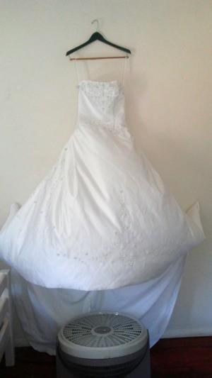 A fan keeping a wedding dress fresh and unwrinkled.
