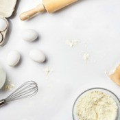 A collection of baking ingredients on a white background.