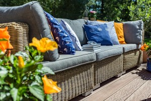 An outdoor couch with lots of cushions.