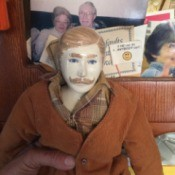 Identifying a Porcelain Doll - male doll wearing a plaid shirt and brown sweater