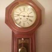 Value of a Regulator Wall Clock - wall clock with a pendulum