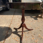 Value of a Mersman Table - round pedestal table with three legs and a drawer