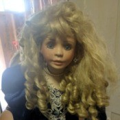 Value of a Circle of Friends Doll - large doll wearing a dark blue dress with lace at cuffs and hem