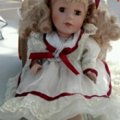 Replacement Certificate of Authenticity for Collectors Choice Doll - blond doll wearing a white dress trimmed with red ribbon