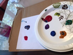Use a Cardboard Place Mat for Kids' Painting Crafts - piece of cardboard under paper being used for a painting project