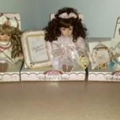 Value of Collector's Choice Porcelain Dolls - three dolls in partial boxes