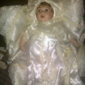 Information on a Cathay Collection Doll - baby doll in christening dress