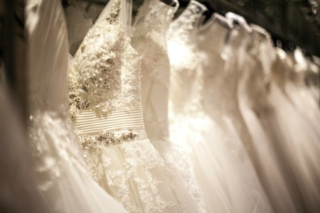 White wedding dresses hanging in a row.