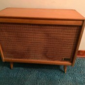 Value of Zenith Cabinet Record Player - rather plain stereo cabinet with large area covered with cloth over the speakers
