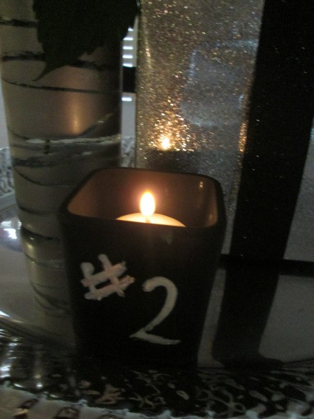 A spray painted votive with a #2 written on it.