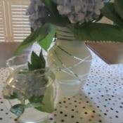 Rubber Band Art Painted Vase - white vase and a smaller clear vase arrangement