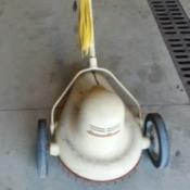 Value of a Vintage Rumsey Electric Mower - tan teardrop shaped mower