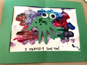 Turtle Framed Art - framed painting with decorated turtle in the center and caption on the bottom