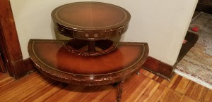 Background Information on an Antique Table Set - two leather topped tables, one round one half round