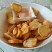 Bread Chips on plate with dipping sauce