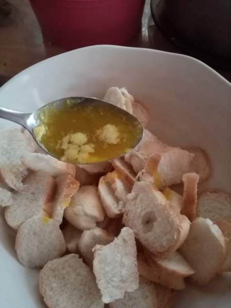 spooning butter on Bread Chips