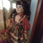 Value of this Dynasty Doll - doll in a glass case