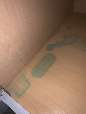 Removing a Windex Stain on Bathroom Cabinet - blue stains on bottom of cabinet