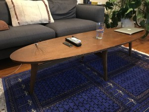 Age and Value of a Mersman Surfboard Coffee Table - table on blue rug in front of couch