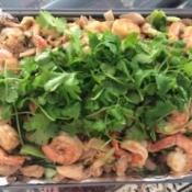 Stir Fried Flat Noodles with Chicken and Shrimp garnished with cilantro