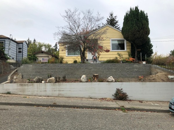 New Retaining Wall and Early Plantings - house with wall and first plantings in the fall